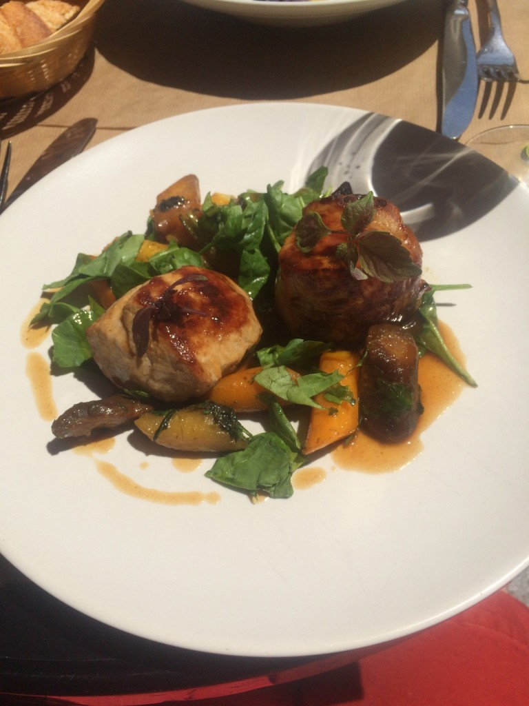 plate of pork, carrots, and greens