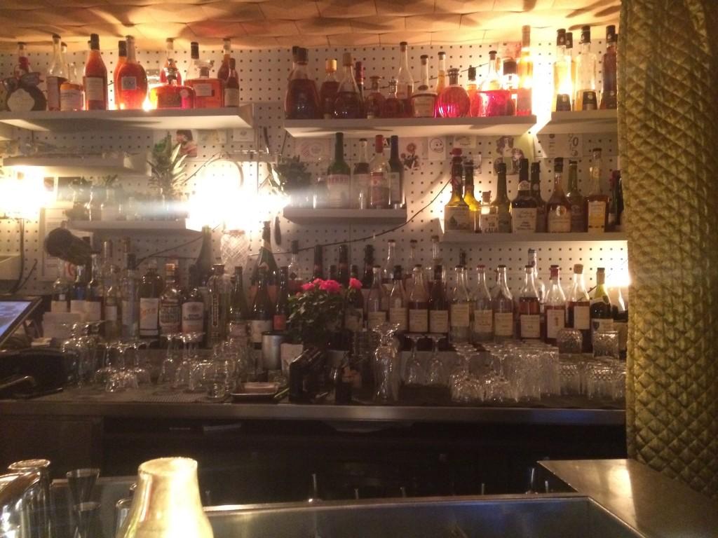 bottles at le syndicat bar