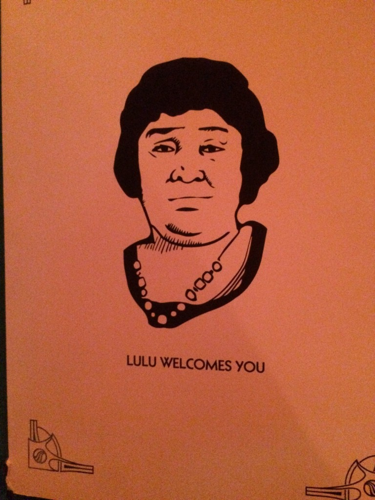 """Paper reading """"Lulu Welcomes You"""" with picture of lulu"""