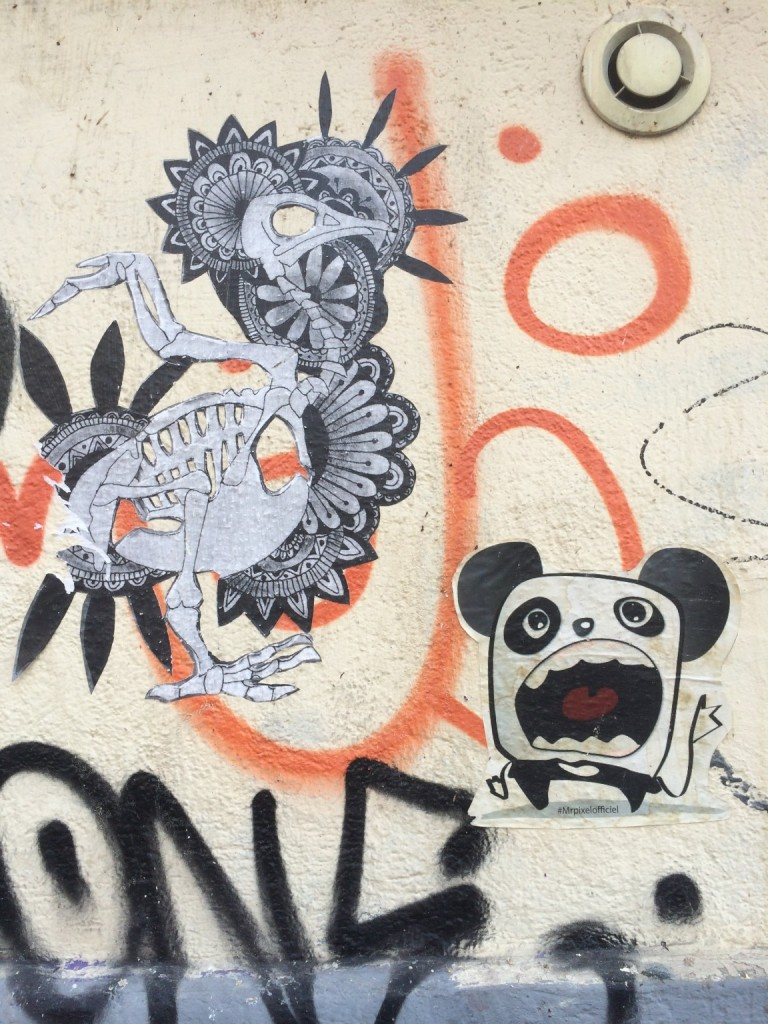 graffiti of a hungry panda and necro rooster
