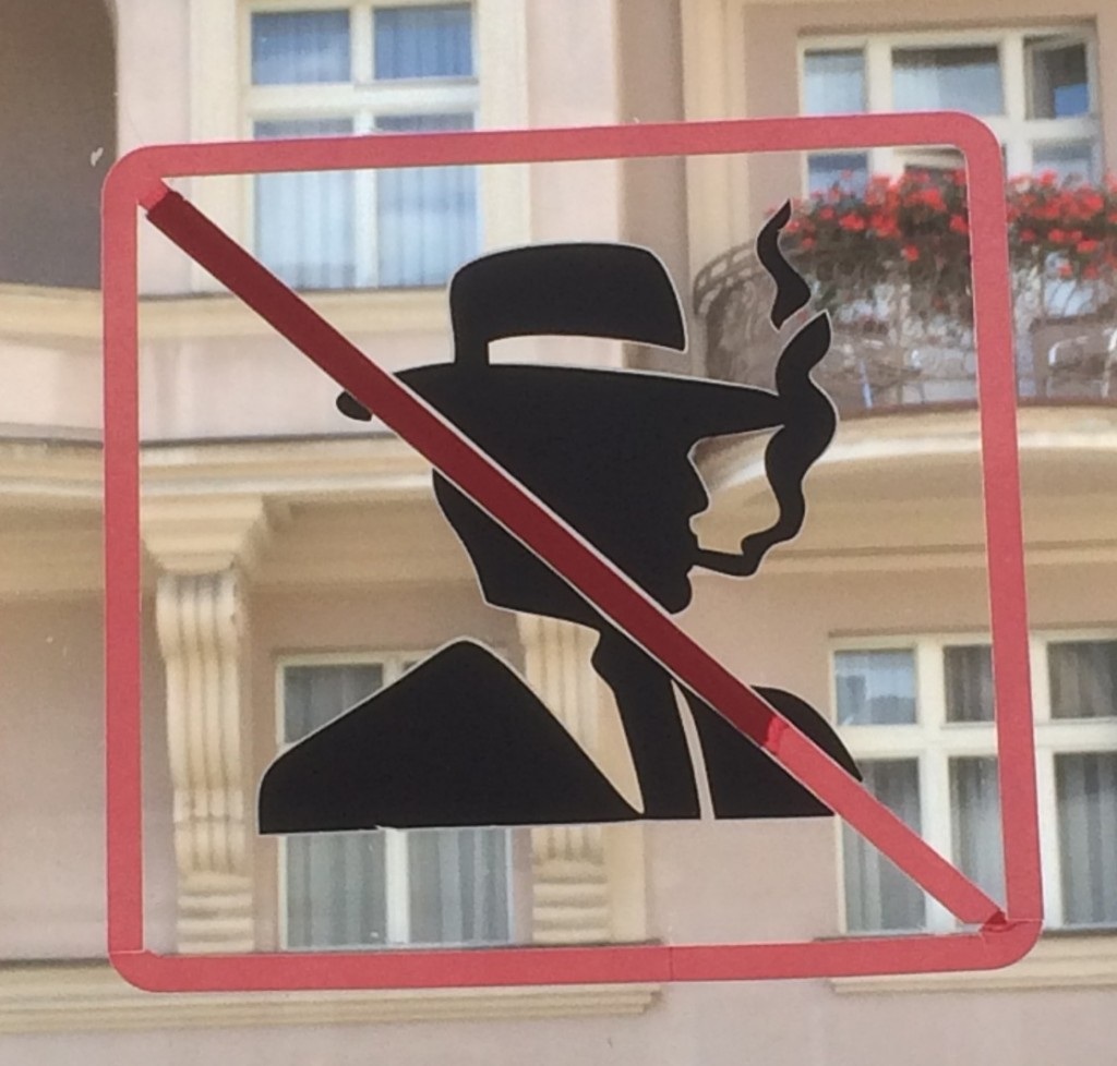Man in fedora with cross-out not allowed sign