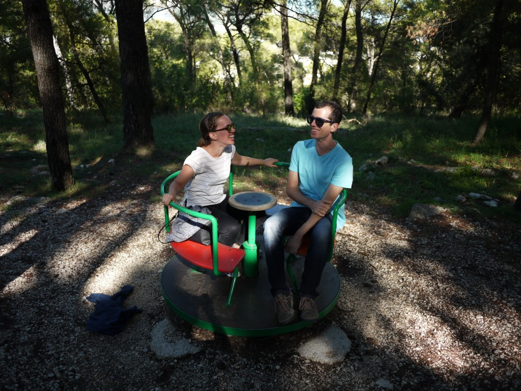 We found a playground near the trail and had to stop to enjoy it. Gary took this photo of us on a spinning disc. I think this is at about the point we wished we weren't spinning anymore.